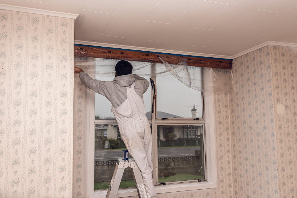 Painter doing an interior painting job