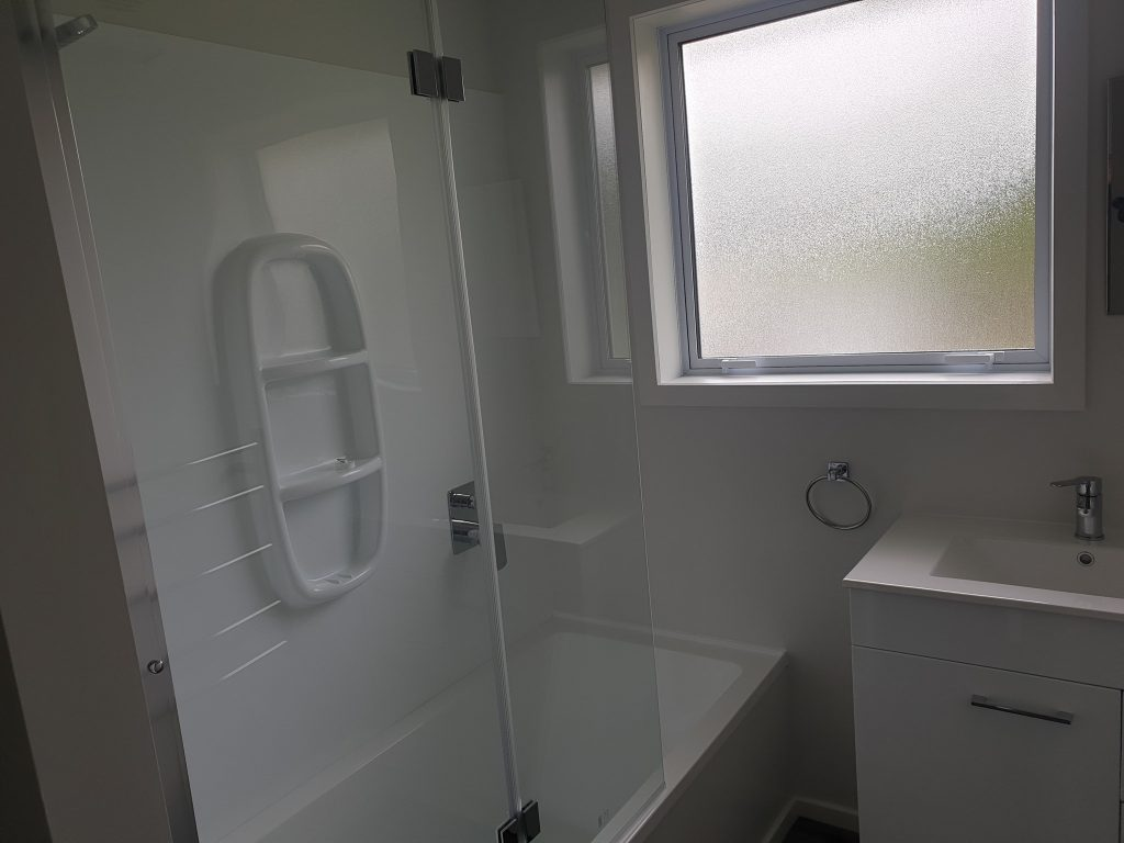 A bathroom that has been upgraded on a rental property
